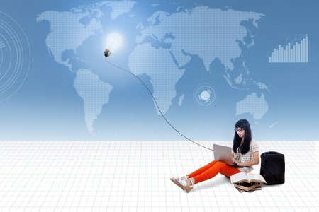 inspirations: Beautiful female typing on laptop under lightbulb with world map background