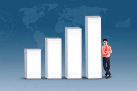 Businessman standing next to bar chart on blue world map background Stock Photo - 21177814
