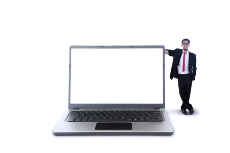 single man: Business manager standing next to big laptop