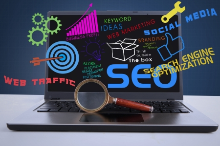 online marketing: An illustration featuring a laptop computer with SEO concept and a magnifying glass in front of the laptop