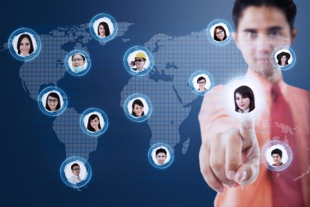 Businessman choosing his partner via futuristic interface with world map background photo