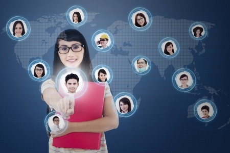 choose person: Asian student choosing her partner on social network by using futuristic interface