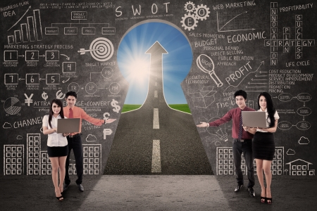 sales lady: Business team present marketing road success through a key hole