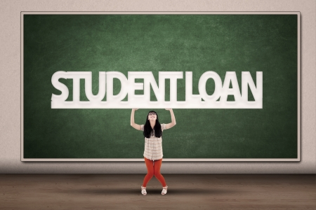 education loan: Young asian college student hold a sign of student loan
