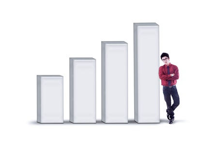 growth enhancement: Businessman standing next to growing bar chart on white background Stock Photo