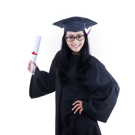 fresh graduate: Excited student wearing graduation gown posing on white background Stock Photo