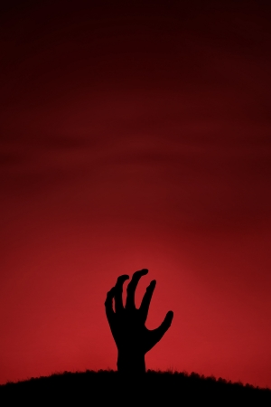A zombie hand coming up from the ground
