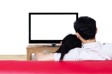 woman on couch: Asian couple watching blank tv on white background - back shot Stock Photo
