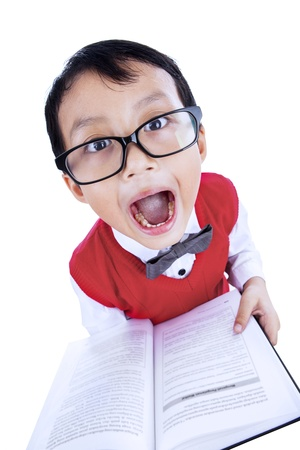 reading glasses: Funny expression of a boy reading a book on white background