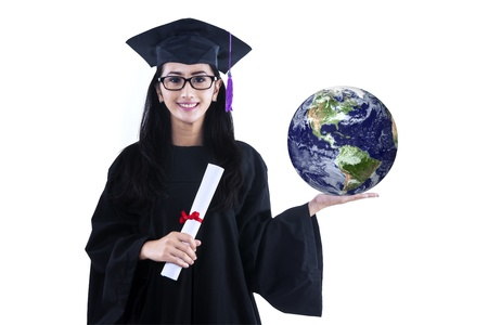 Beautiful female graduate holding 3D earth planet and certificate, isolated on white photo