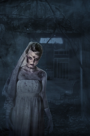 Scary dead bride with scars inside spooky house photo