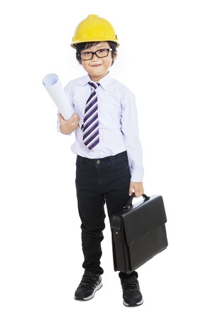 Little businessman construtor holding bag and blueprint on white background photo