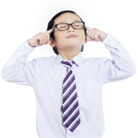 Close-up of little businessman thinking with eyes closed on white background photo