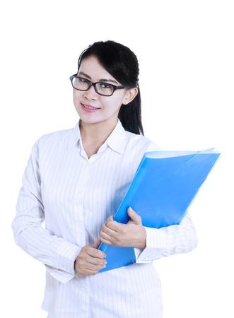Beautiful female doctor is holding blue folder on white background photo