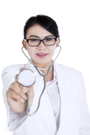 smile close up: Beautiful female doctor showing the stethoscope on white background Stock Photo