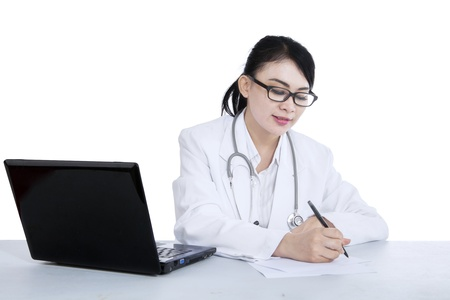doctor writing: Attractive female doctor is writing prescription on white background