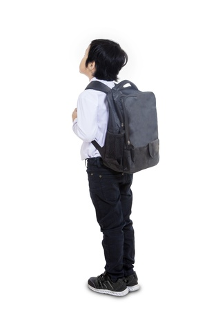 looking behind: Little busineman carry bag, shot from behind on white background Stock Photo