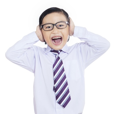 Little businessman is screaming on white background photo