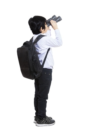 asian: Business kid is using binoculars on white background