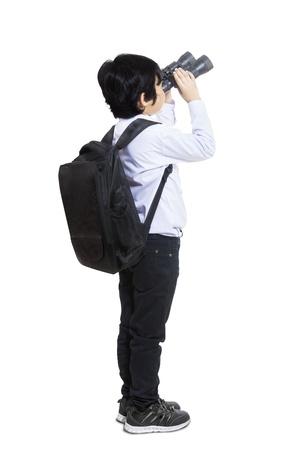 hopeful: Business kid is using binoculars on white background