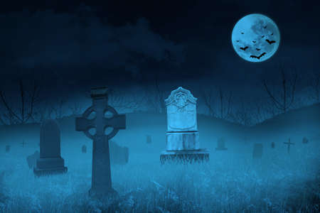 Ghostly graveyard under blue full moon for halloween background photo