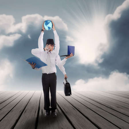Business concept with multitasking businessman with his jobs under blue sky Stock Photo - 22013444