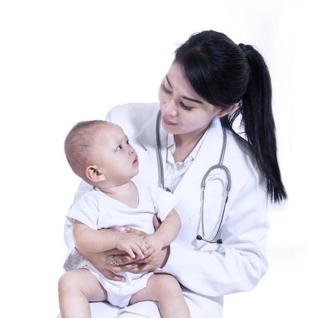 doctors tool: Adorable doctor with a baby in her arms isolated on white background