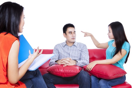 Isolated young angry fighting couple on couch Stock Photo - 22114519
