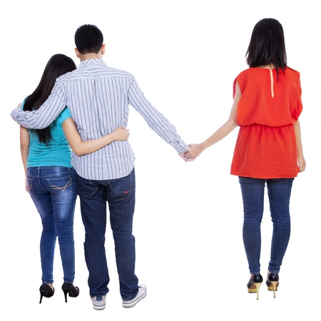 cheating woman: A young man cheating with another woman isolated over white background Stock Photo