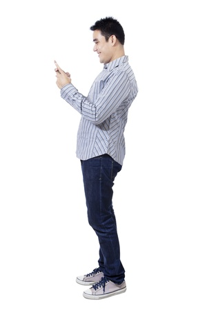 Happy asian man using a mobile phone on white background photo