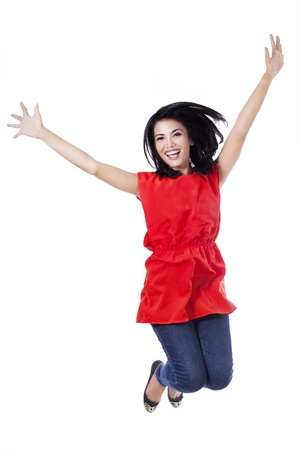 Happy attractive woman jumping in the air - isolated over a white background  Stok Fotoğraf