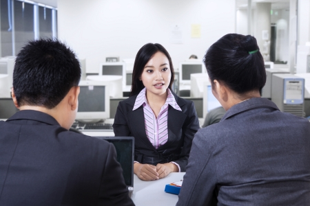 candidate: Recruiter checking the candidate during job interview at office Stock Photo