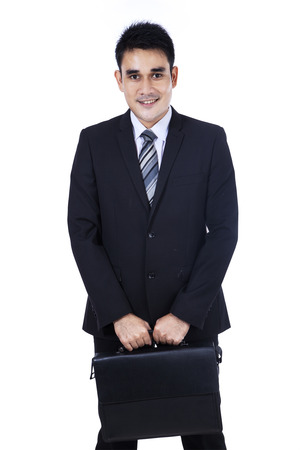 Business man with briefcase standing on white background photo