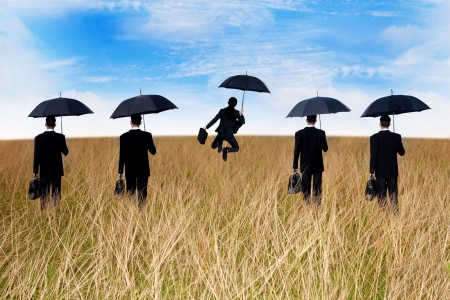jump suit: Businessmen insurance agent on the meadow with umbrella