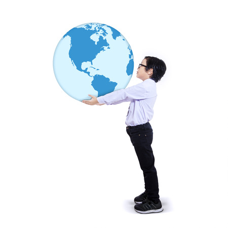 Child holding the earth isolated on white background photo