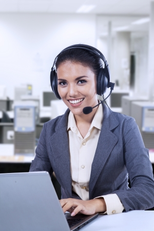 representative: Female customer support operator with headset and smiling