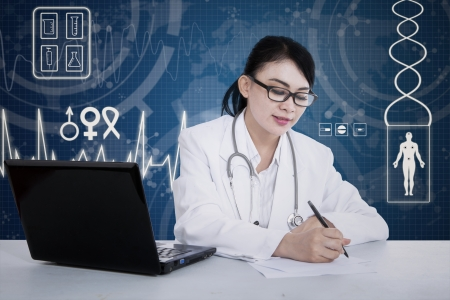 Female doctor is writing prescription with modern digital background photo