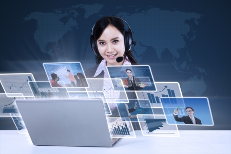 asian business: Asian businesswoman working on her laptop with  world map background