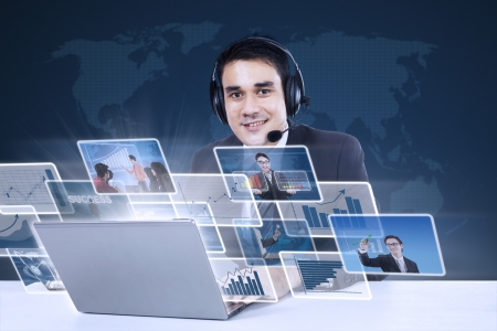 asian man laptop: Customer service with internet online on blue world map background Stock Photo