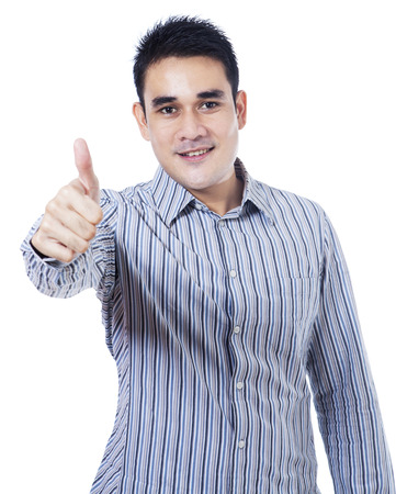Asian businessman showing thumb up isolated on white background photo