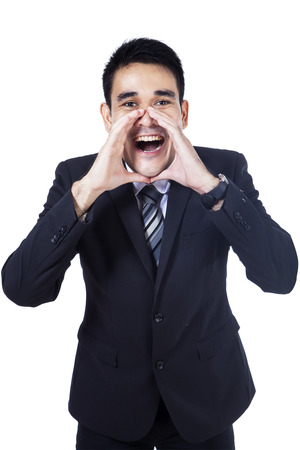 Young businessman screaming out loud isolated on white background photo