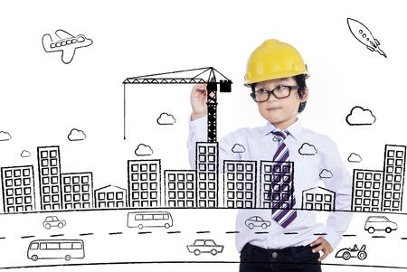 hispanic boy: Little boy drawing a building on transparent board Stock Photo