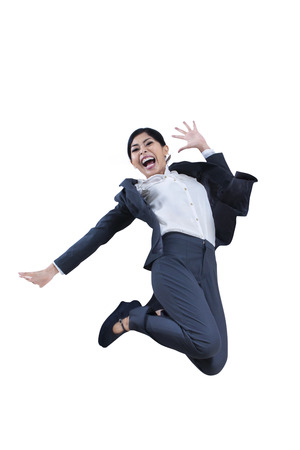 Happy businesswoman jumping of winning over white photo