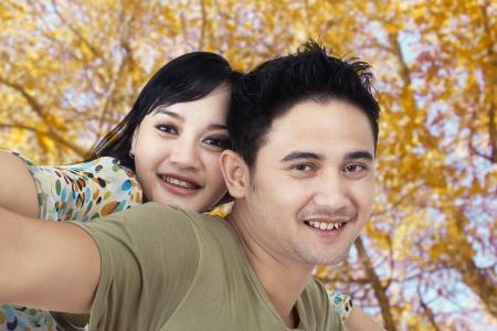 Happy couple enjoying at autumn park Stock Photo - 22305217