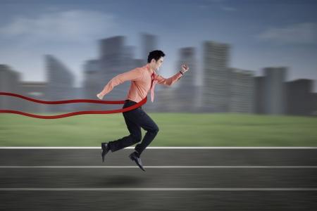 winner man: Asian businessman winning in business competition