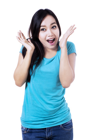 Young woman with surprised expression, isolated over white background  photo