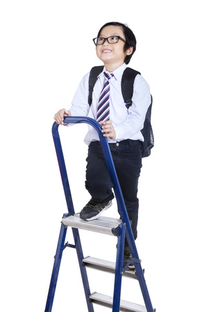 Child climbing a ladder isolated on white background photo