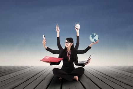 multitasking: Busy business woman multi tasking