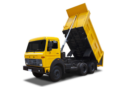 Yellow dump truck with shadow isolated on white background photo