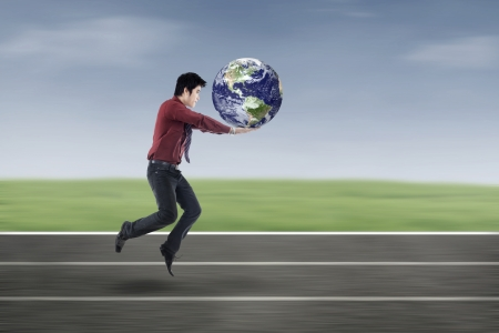 businessman jumping: Asian businessman in race with earth as a symbol of global business race Stock Photo